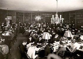 many students congregate in a library room