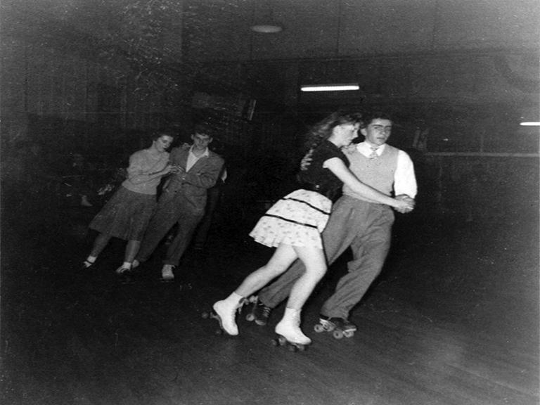 A young couple roller skating circa 1947