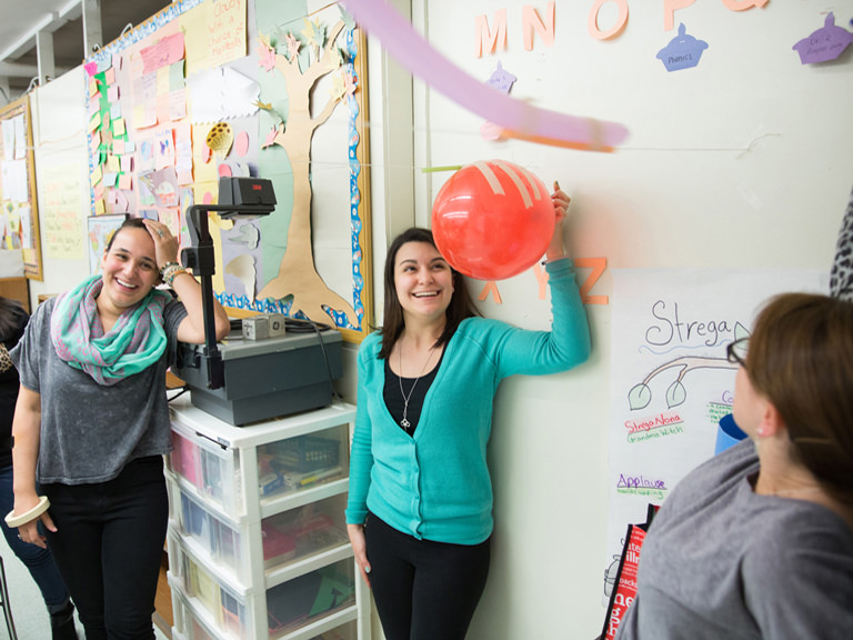 Teachers with balloon.
