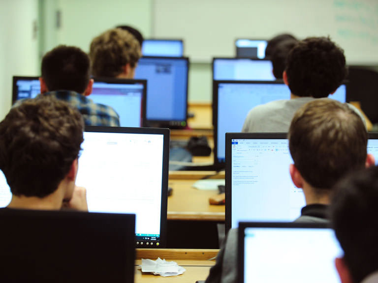 students staring at computer screens