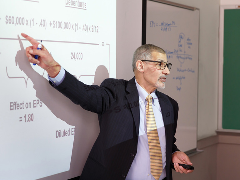Accounting professor gives class lecture.