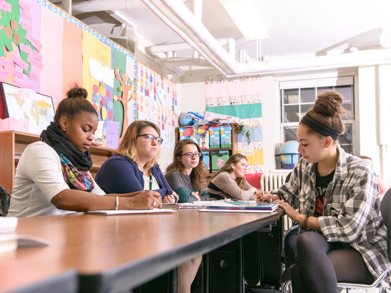 Students participate in class discussion.