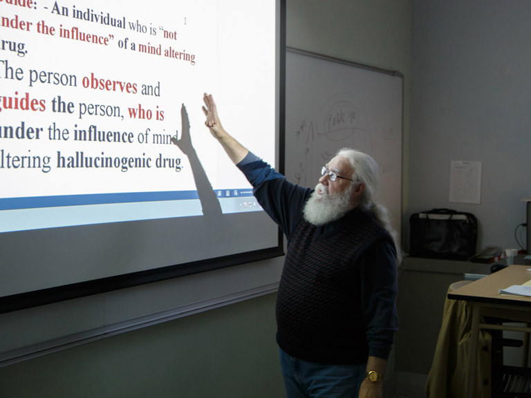 Allied health professor gives class lecture.