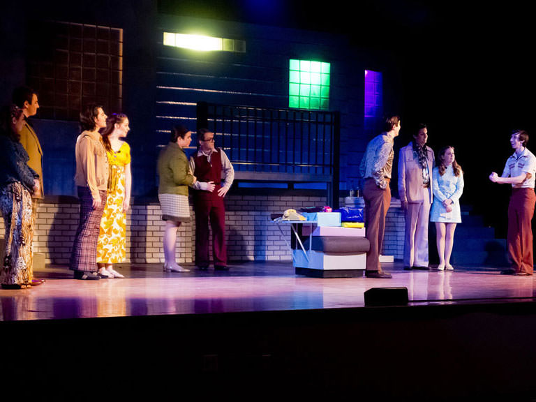 Students perform in a play at the College.