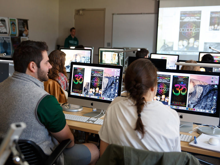 Students learn graphic design in the lab.