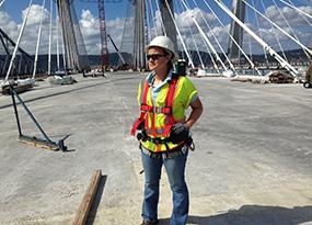 Image of Diana Brown in front of bridge.