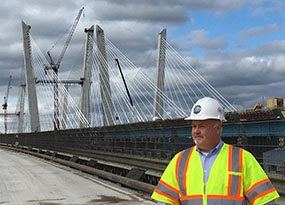 Image of Tom McGuinness on bridge.