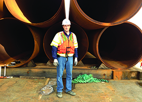 Image of Tony Canale '94 in front of construction materials.