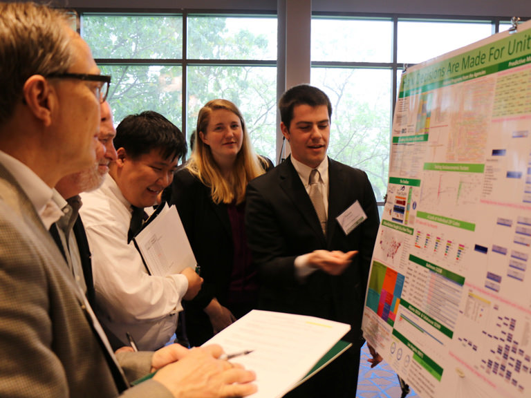 Contest participants presenting poster