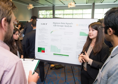 student presents poster during competition