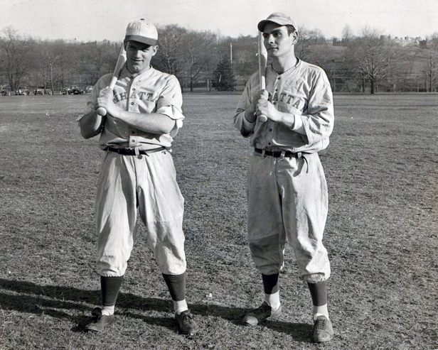 Photograph of two Manhattan College Baseball players on the field.