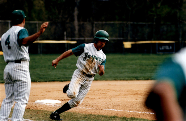 Photograph of Manhattan College Baseball rounding third base in 1998.