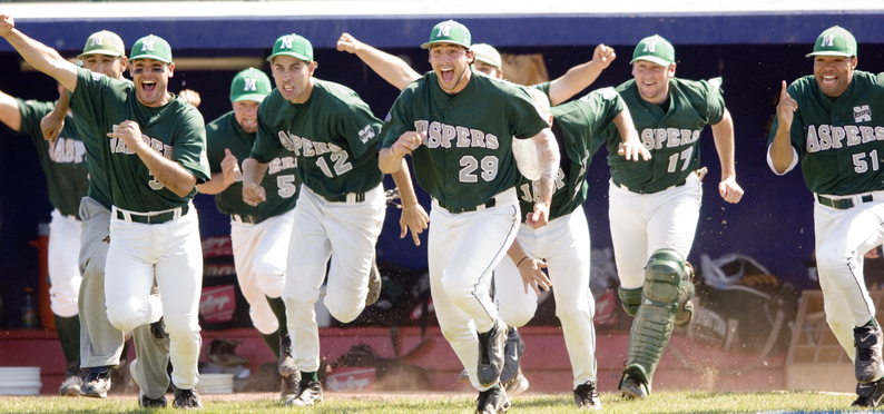 2006 Manhattan College baseball players running from dugout celebrating winning championship.
