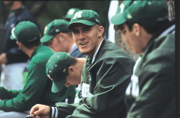 Manhattan College Baseball players in dugout.