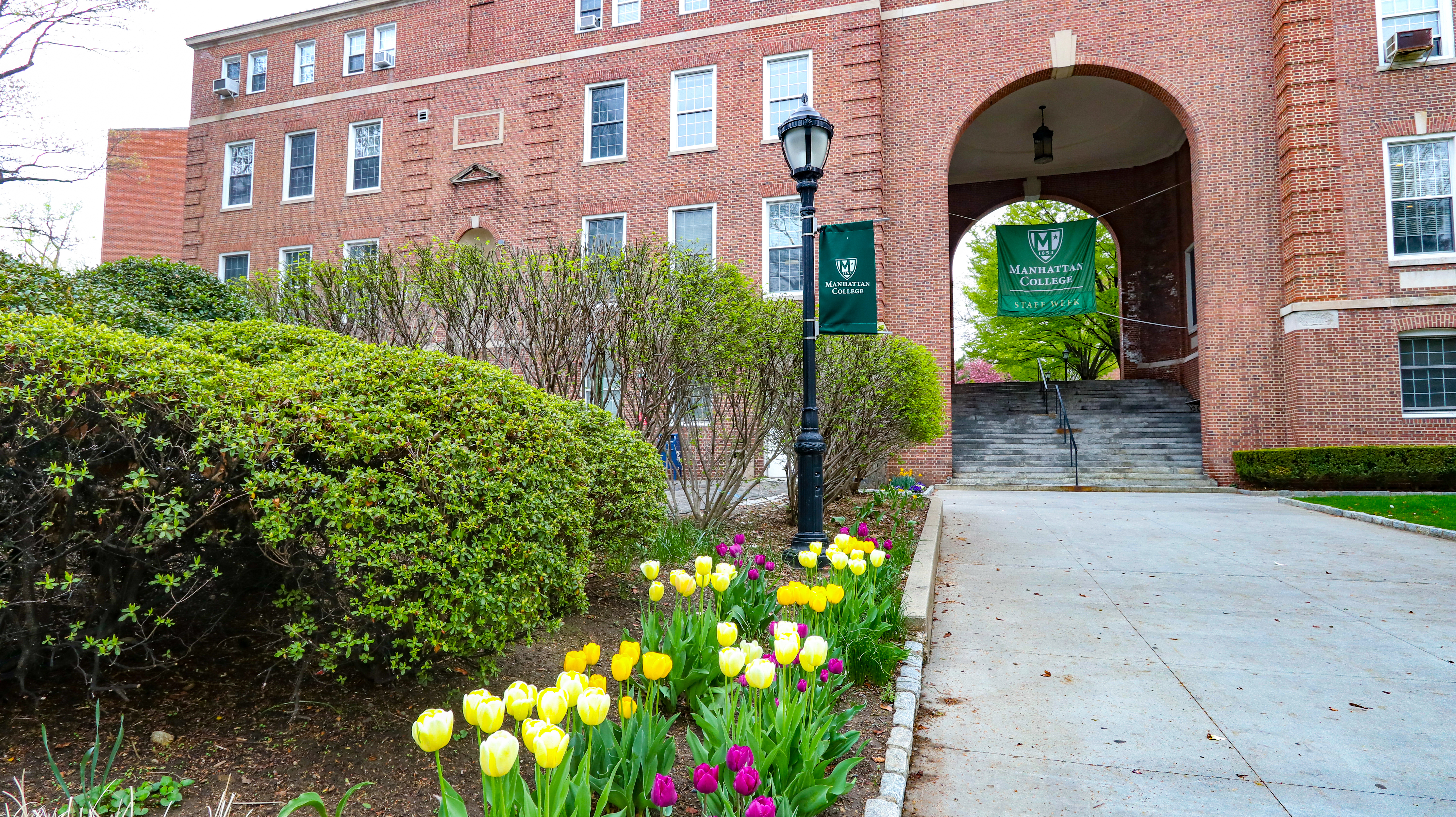 Photograph of path leading up to main archway on Manhattan College campus