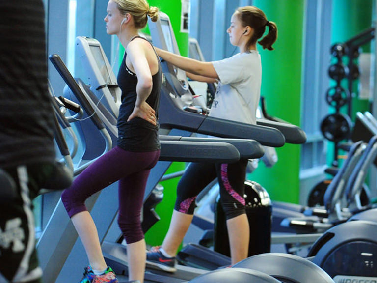Students do cardio at the Fitness Center