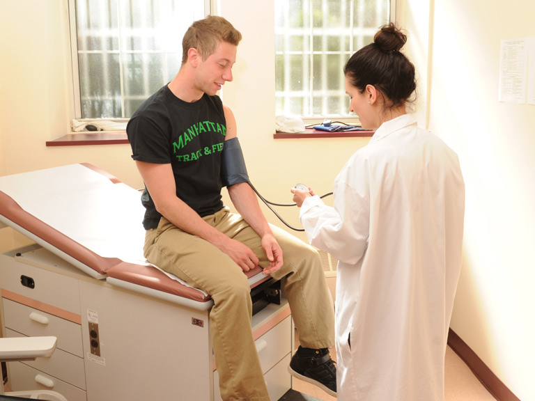 A student getting his blood pressure checked at the health services office