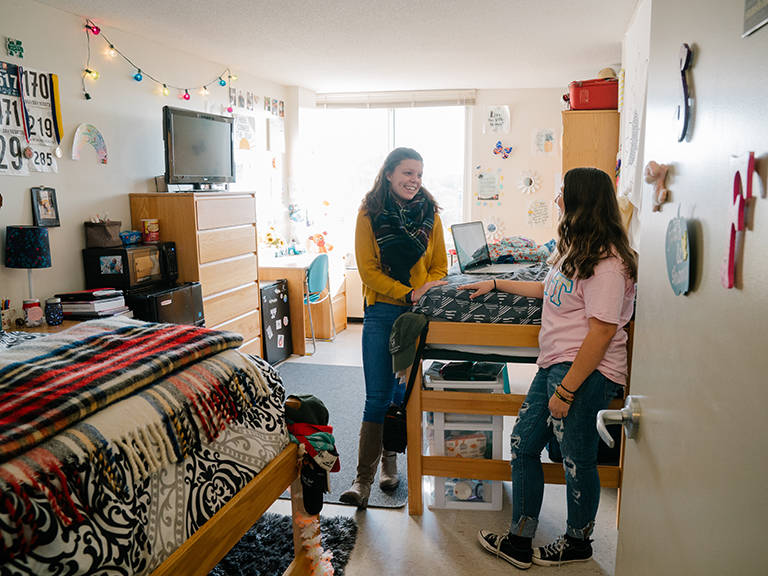 Two students in their dorm room