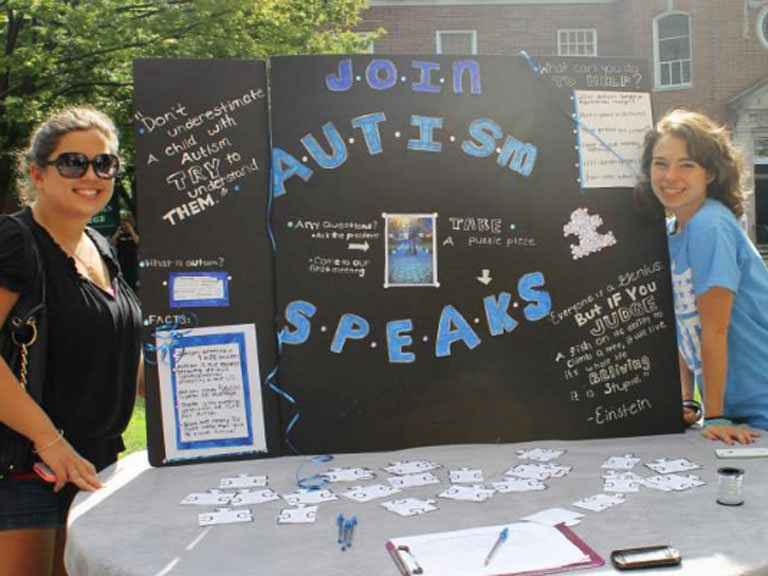 Members promote Autism Speaks U in the Quadrangle.