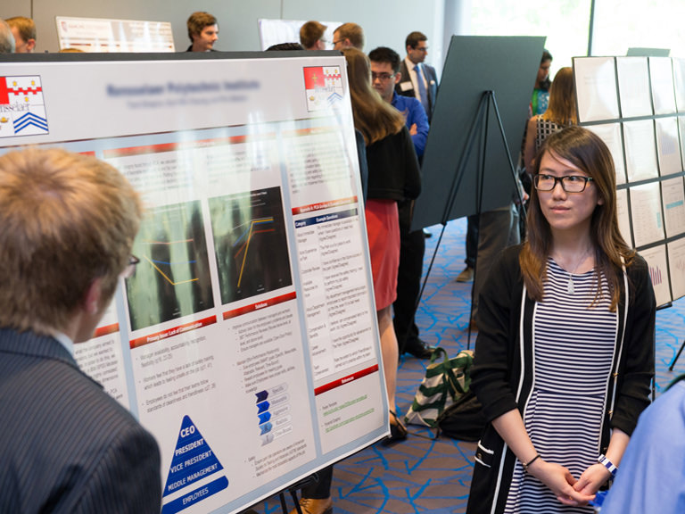 Students show off their presentations at the annual Business Analytics Competition.