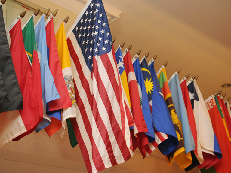 Flags of different countries in Smith Auditorium.