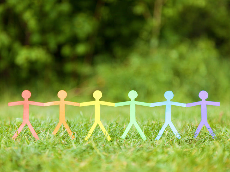 Rainbow-colored stick figures holding hands in acceptance.