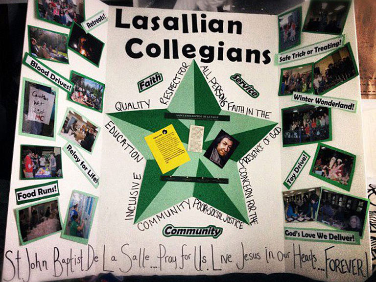 Lasallian Collegians present a poster advertising the organization.