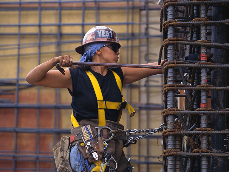 woman wearing hard hat on construction site