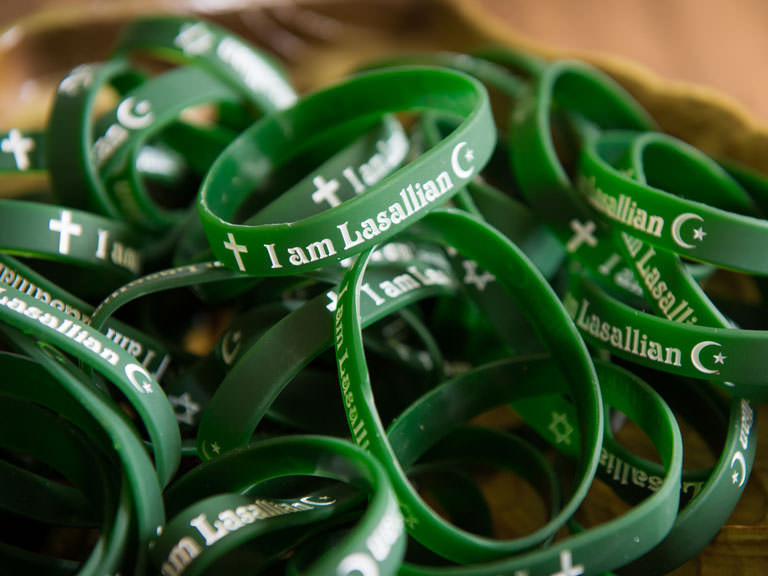 Lasallian wristbands are given out on campus.