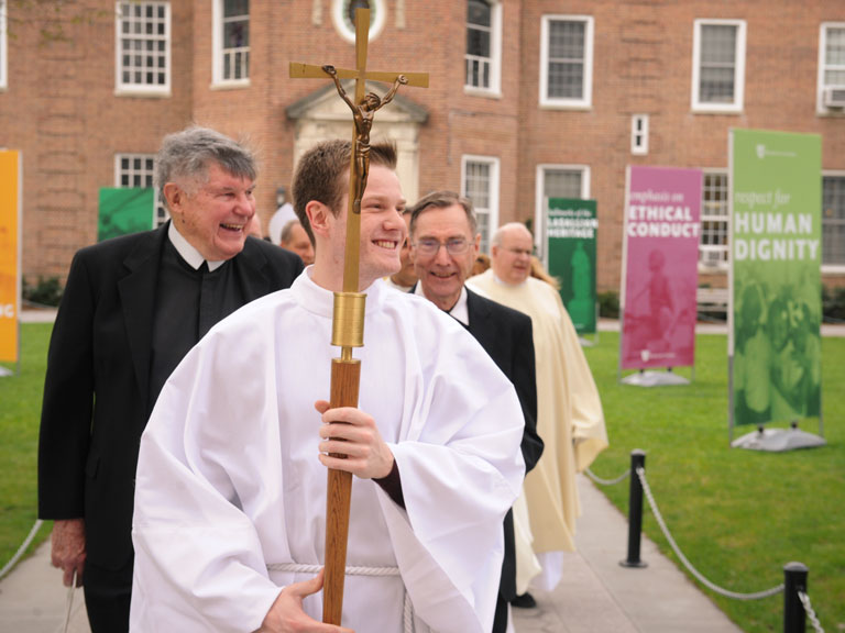 A special processional across the Quad begins Mass at Manhattan College.