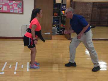student conducts fall prevention research with alumnus