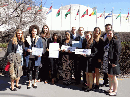 students pose in front of united nations building in nyc