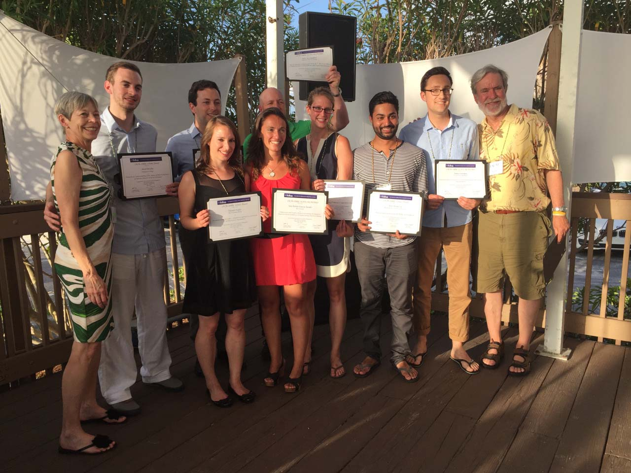 students pose with research awards