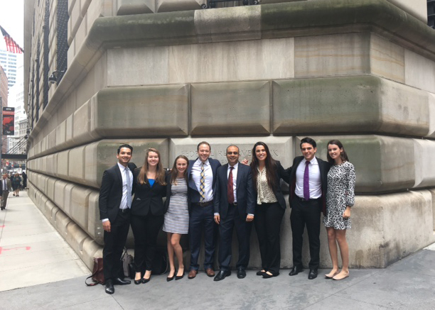 students and professor on wall street