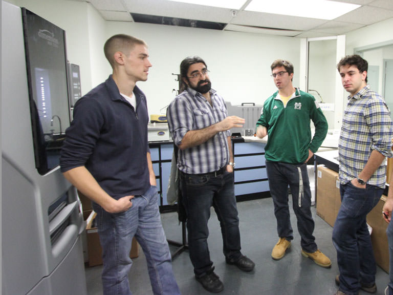 Sina Shahbazmohamadi, Ph.D. with Manhattan College mechanical engineering students