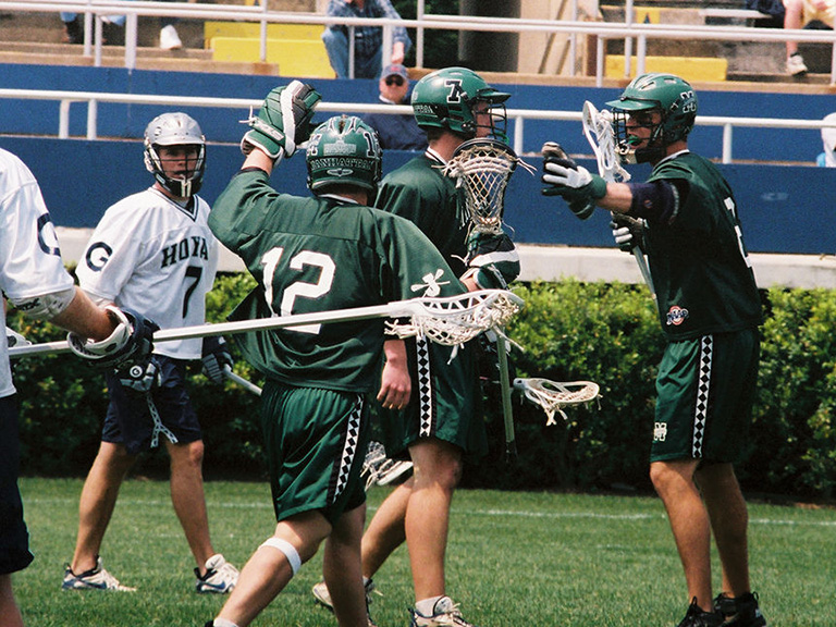 The 2002 Manhattan College men's lacrosse team in action