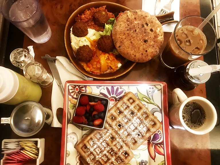 An image of waffles and other food items at Corner Cafe, a restaurant in Riverdale.