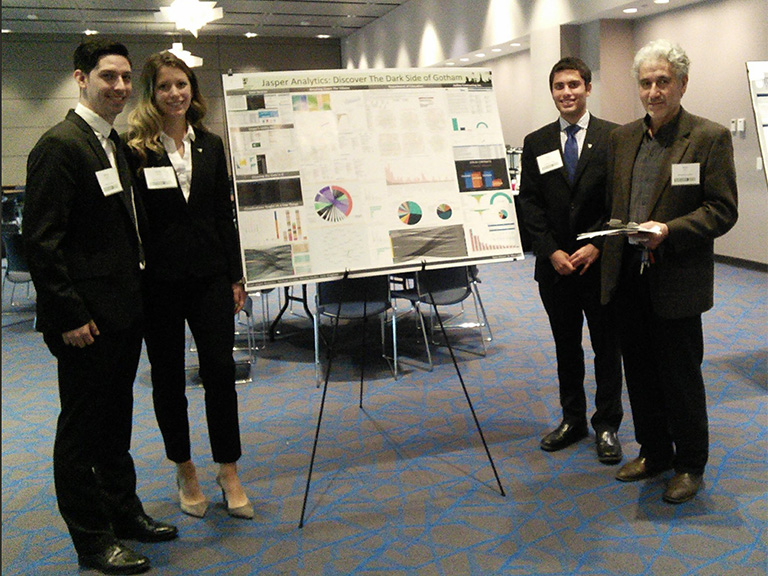 Business analytics group with poster presentation