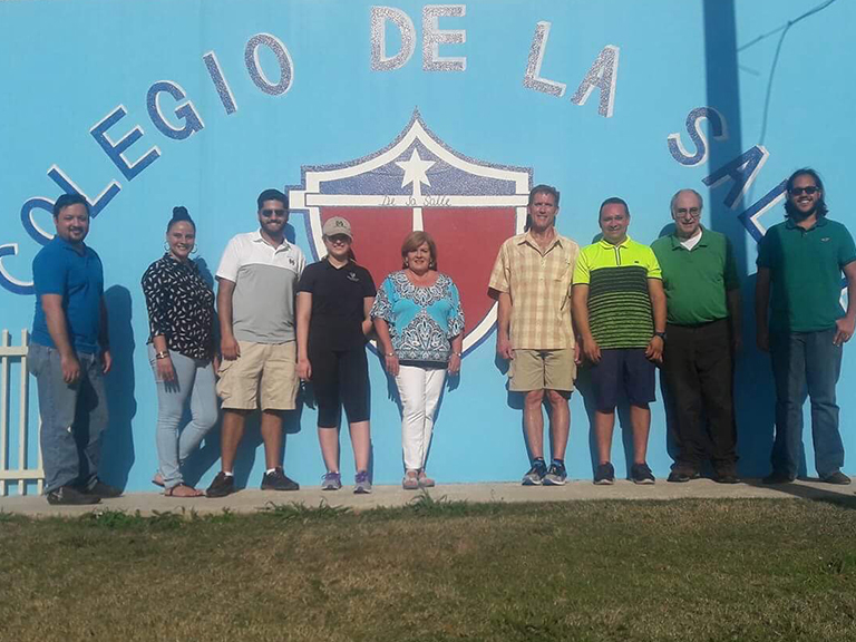 Manhattan engineers pose in front of Colegio De La Salle in Puerto Rico.