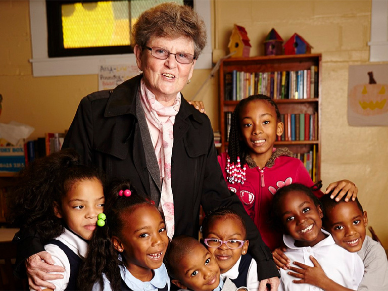 Sister Tesa Fitzgerald with young students