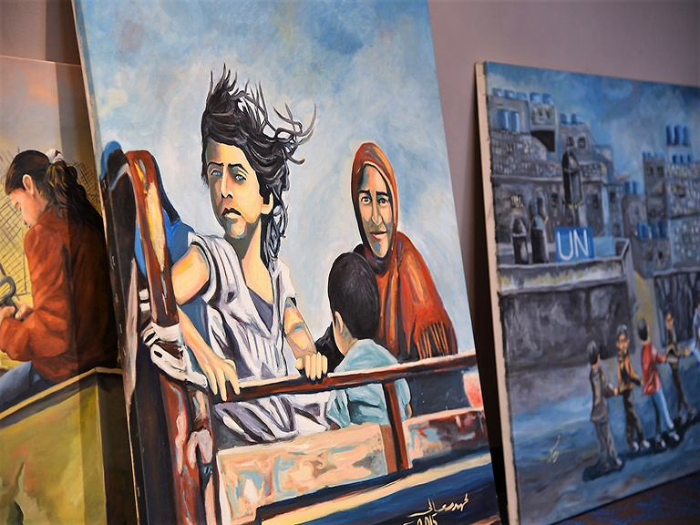 Two paintings from Bethlehem Beyond the Wall exhibition.