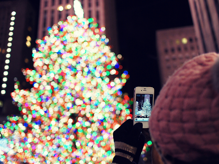 image of person taking photo of christmas tree