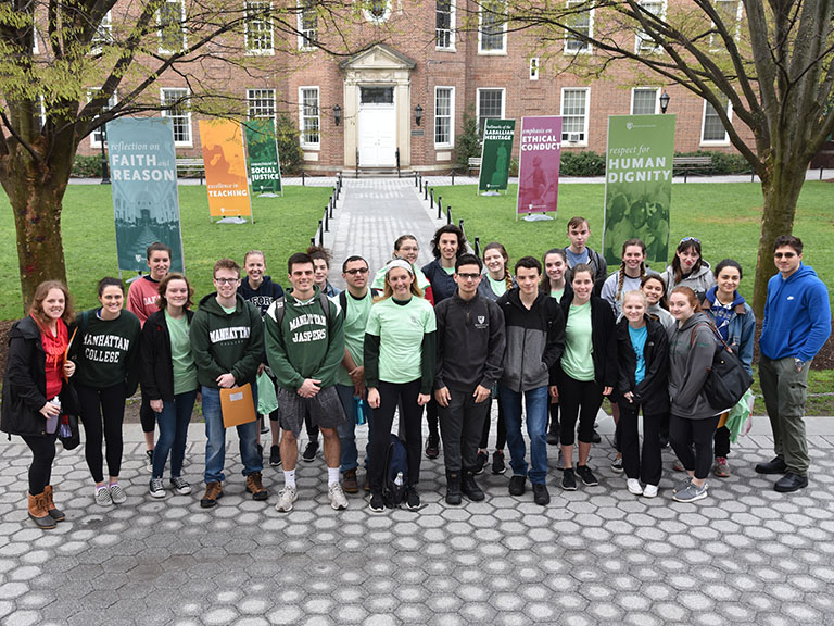 An image of a group of students posing together on campus.