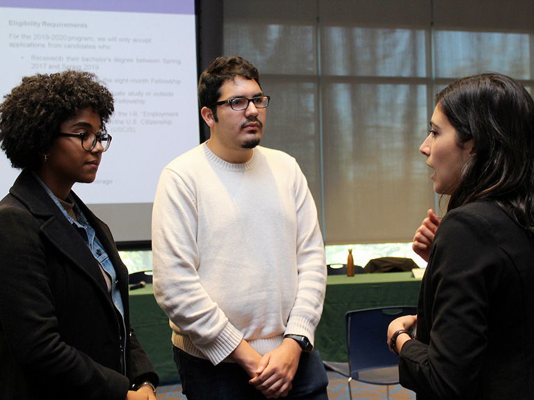 Students speaking with NYC public official after event