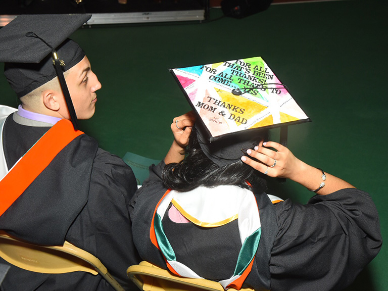 Student with a graduation cap thanking parents