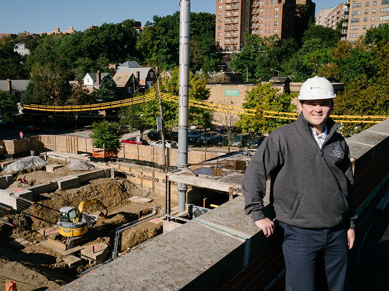 Matt McMorrow '19 at construction site at Higgins Center