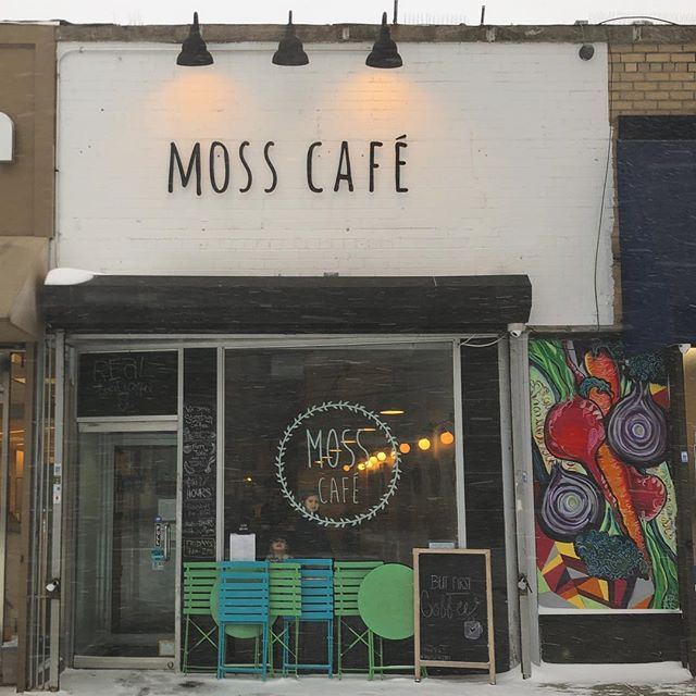 An outside image of the storefront of Moss Cafe, a Riverdale restaurant.