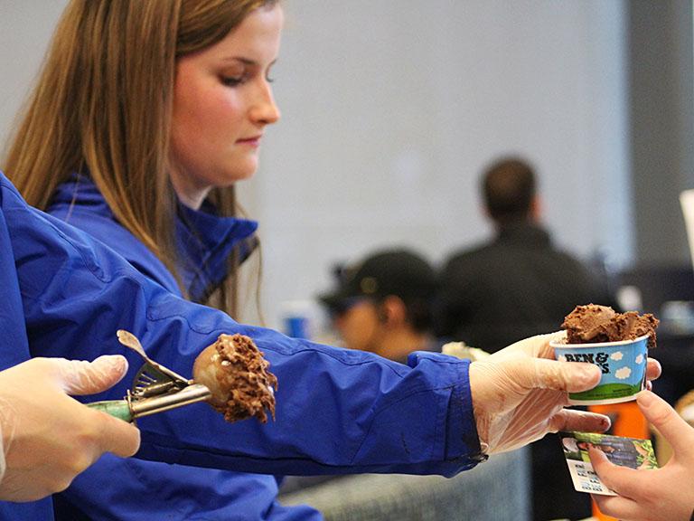 Student scooping ice cream.