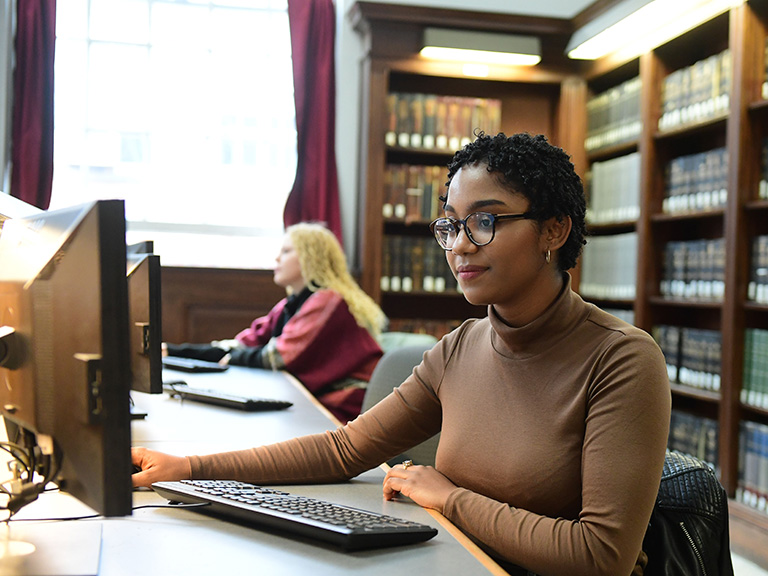 Woman at computer in library