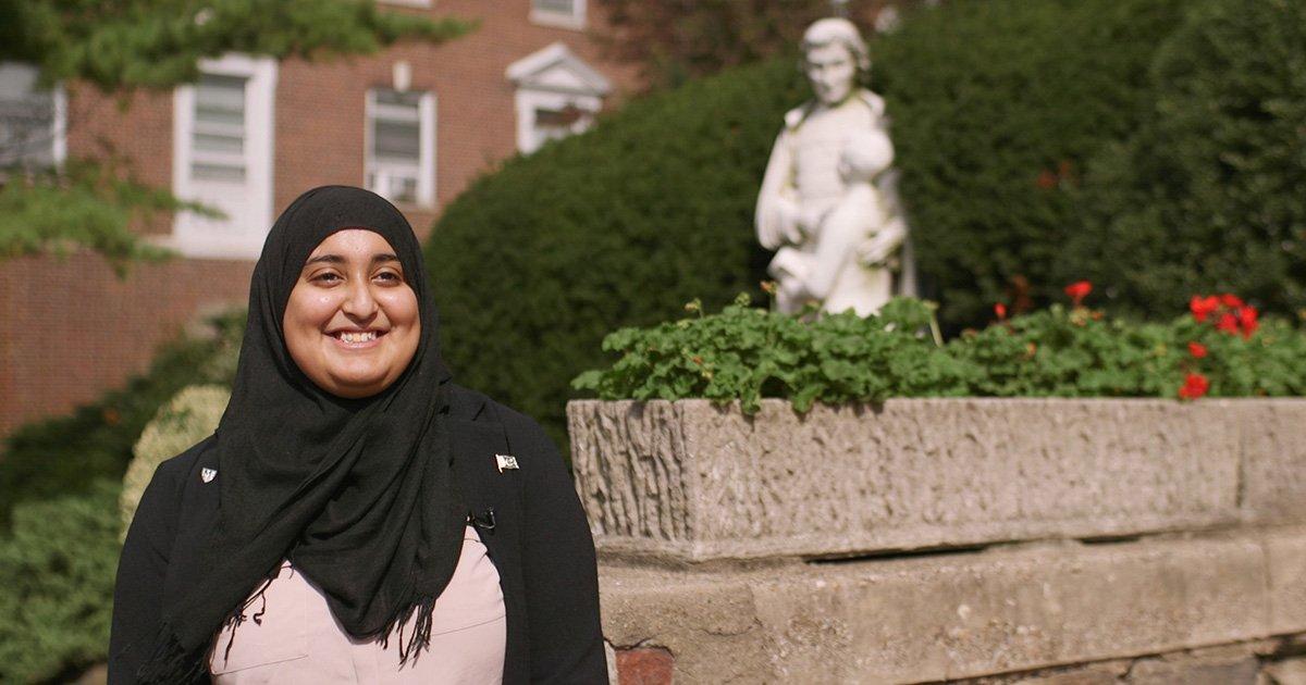 Rabea Ali smiling on campus